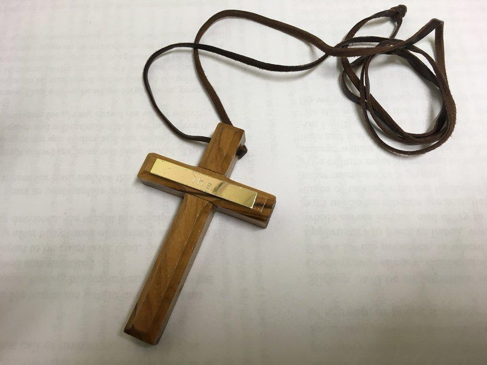 Cross worn by an Alongsider.