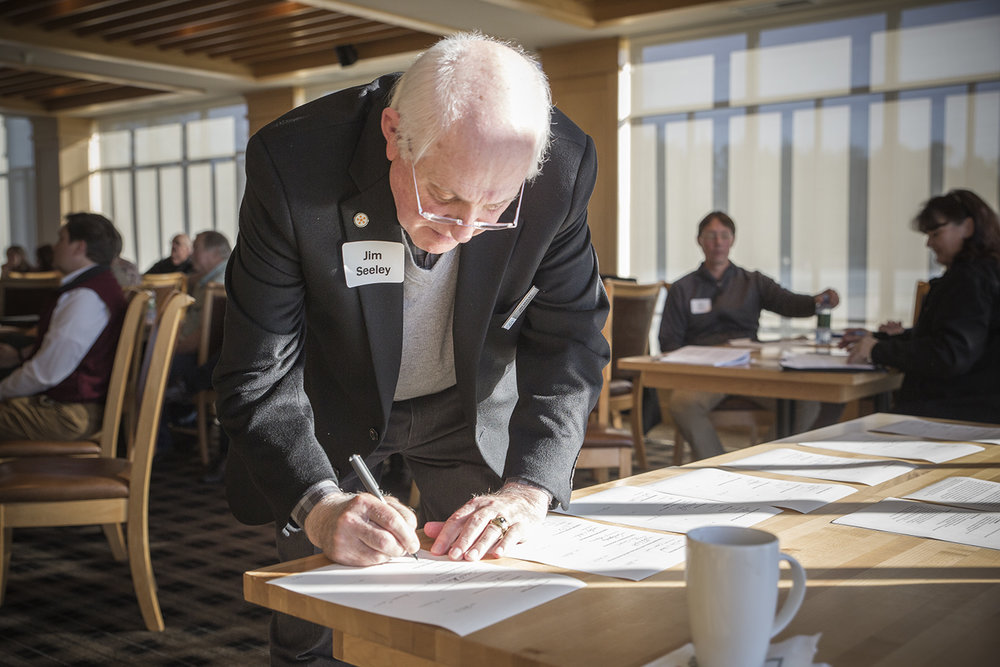 Jim Seeley, Executive Director of the Wild Rivers Coast Alliance and Co-convener of the Oregon Solutions Gorse Project, seen signing the DOC.