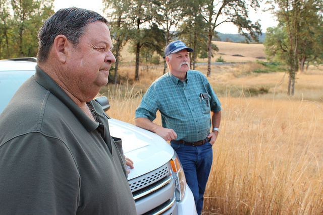 Jeff Baxter (left) and David Chain review the conservation plan that transformed Baxter Ranch. NRCS photo by Spencer Miller.