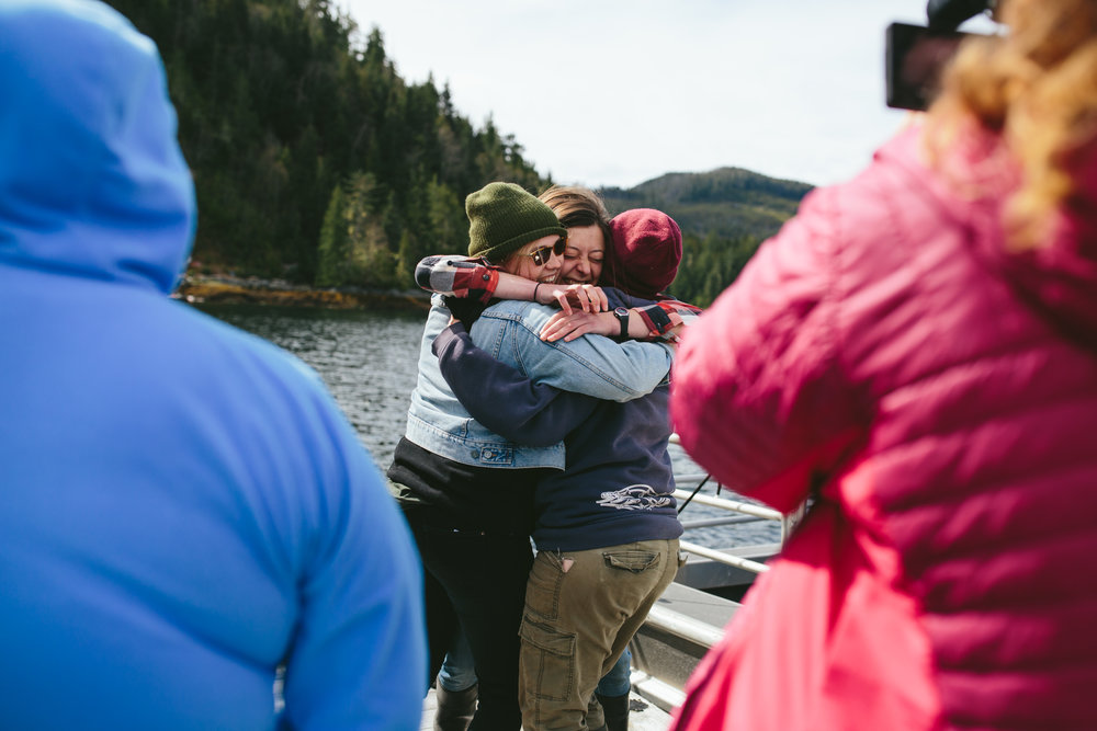 Big hugs and hellos on the Salmon Coast dock.