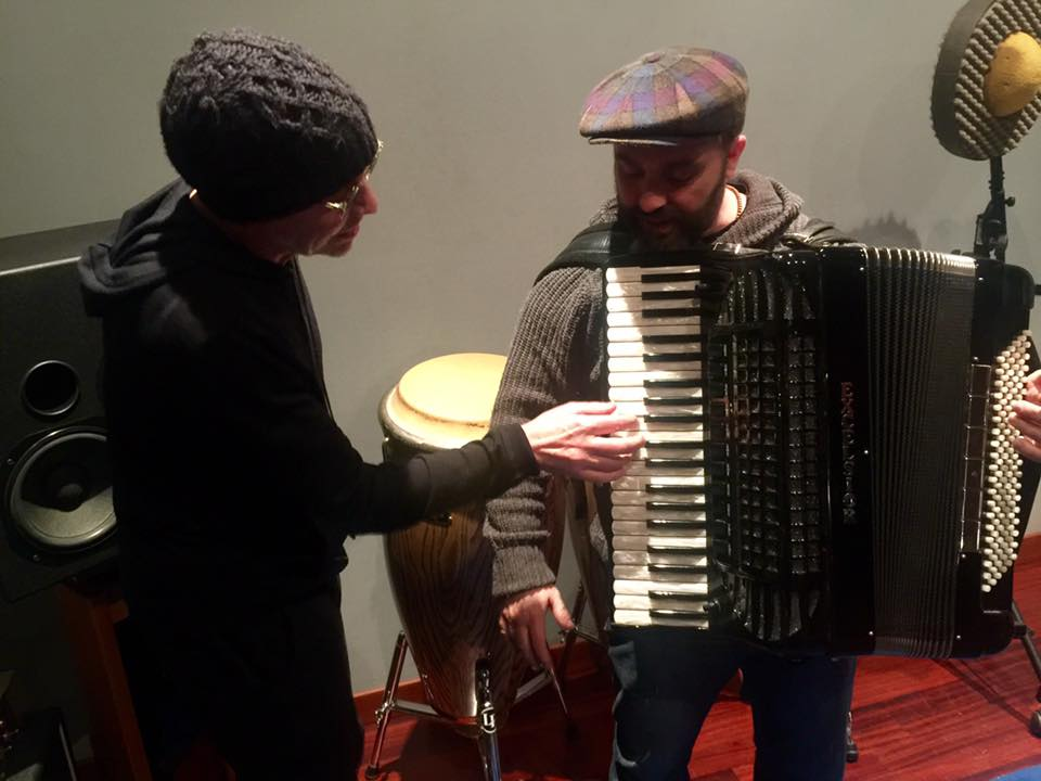 In the Rock and Roll Hall of Fame in Cleveland, Ohio, is my Brothers in Arms accordion which I've loaned to them to exhibit. This isn't it in this pic of me and Primiano De Biase, but it demonstrates how I played it on the song Brothers in Arms: Guy Fletcher squeezed it while I played the melody line you hear on the record.