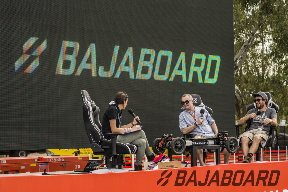 (left-right) Michelle, Craig, and James talking F1 and BajaBoard. Don't those ZQRacing chairs look amazing?!