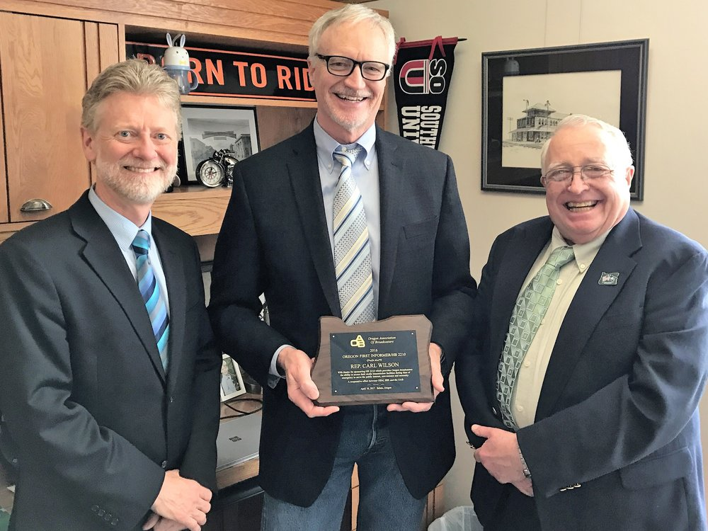 Rep. Carl Wilson (center) co-sponsored HB 2210 which created the First Informer program.  Rep. Wilson was presented a plaque of appreciation during the 2017 OAB Day at the Capitol festivities by Kingsley Kelley (GM of KTVL-TV Medford) and James Boyd (OAB Board Member).