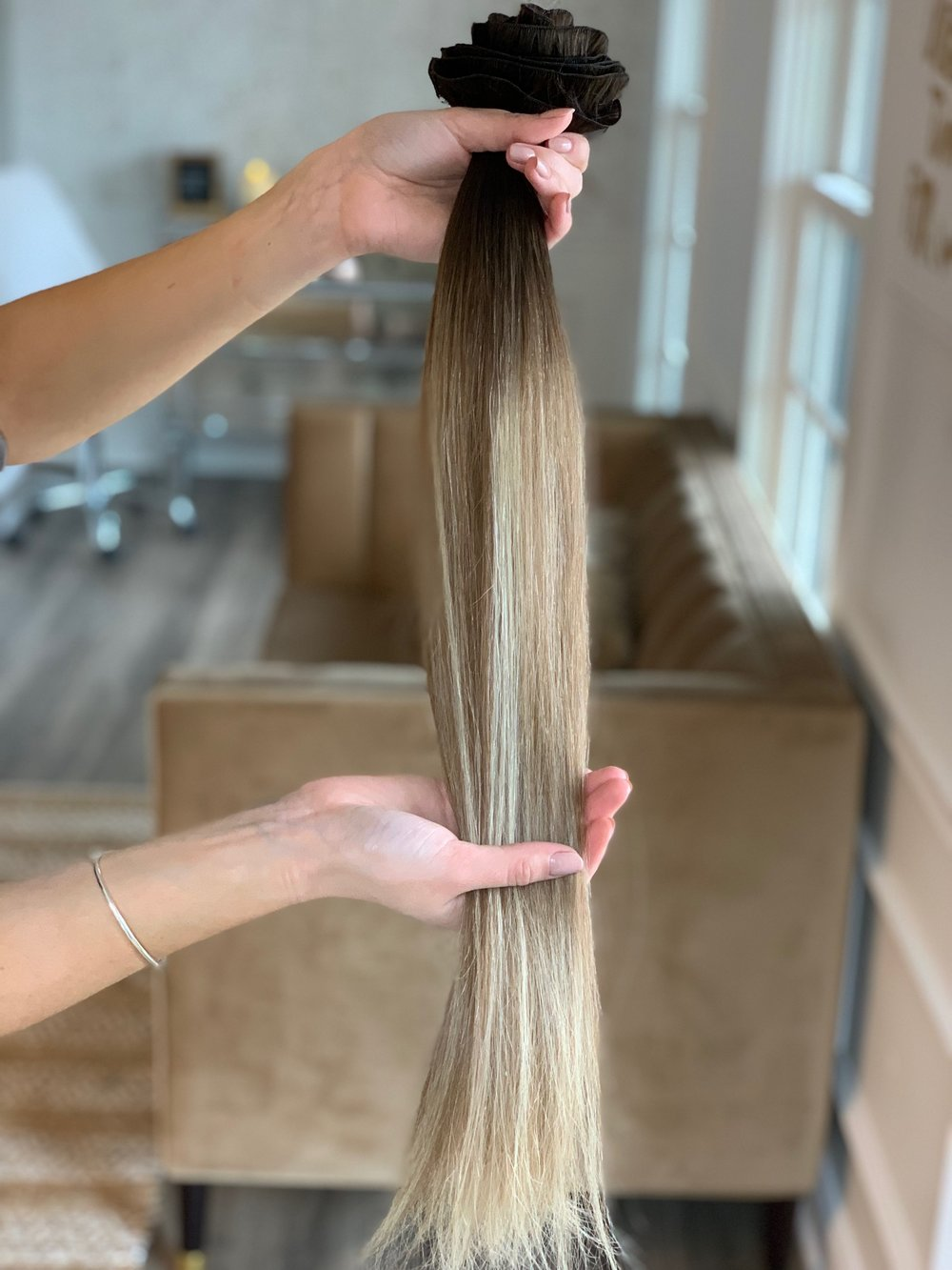 """About the hair… - All handtied wefts are 100% human hair and of incredible quality, we wouldn't have it any other way!During your consultation, Rachel will color match your existing color to the closest match available.We recommend all blonding services be scheduled the week of your installation appointment to ensure a perfect match. Retouches + Glosses may be scheduled same day if desired.Lengths available 