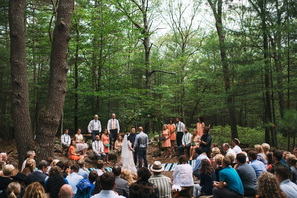 Lauren + Tyler got married at the Alton Jones Summer Research Camp for their surprise wedding. This location is not a typical wedding venue, but it worked magically for their surprise ceremony and huge family-style reception.