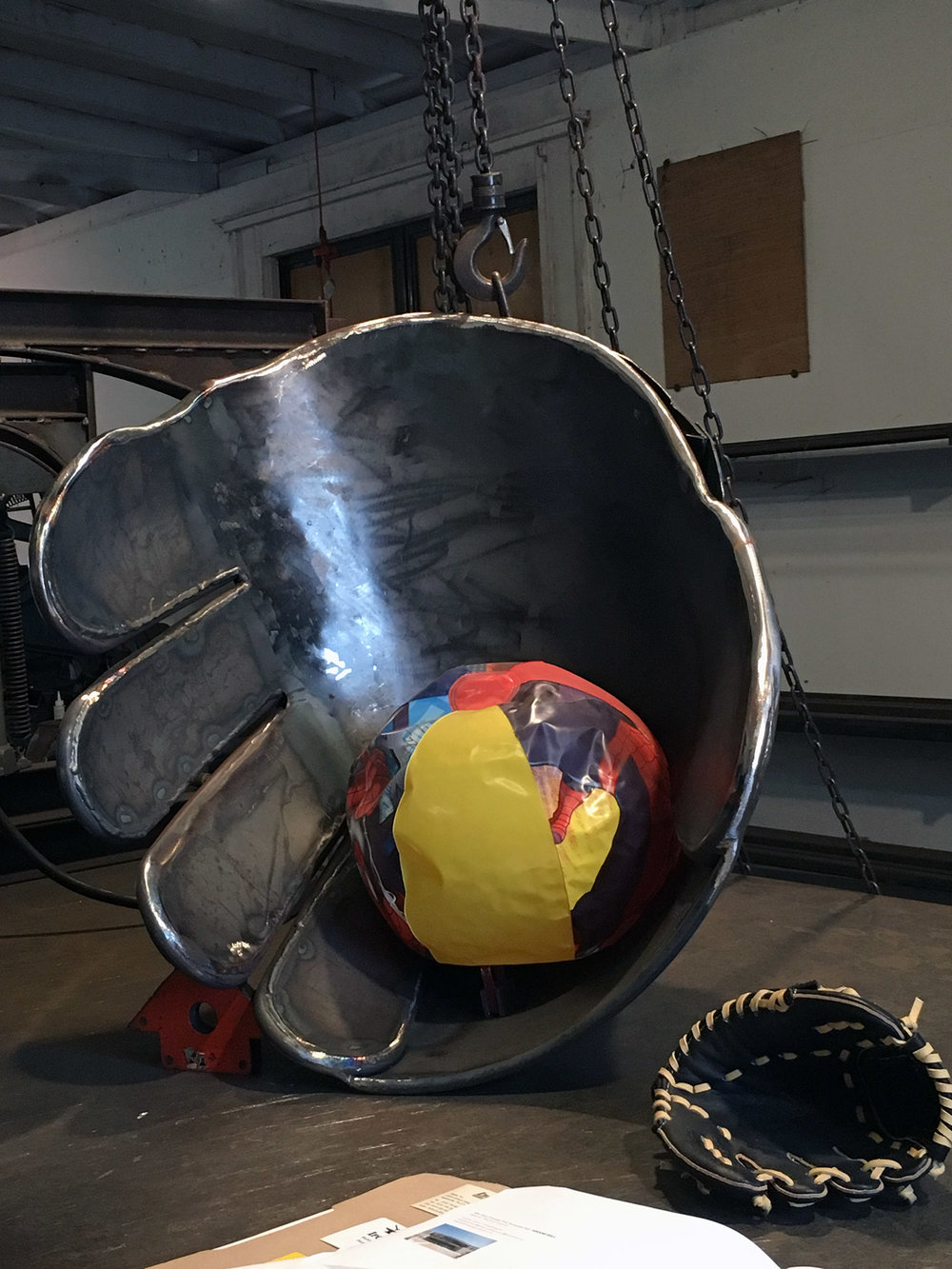 Fabrication with beach ball standing in for 12 inch steel baseball