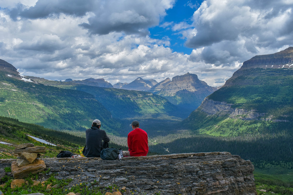 My friends gaze out over the unpopulated expanse of Glacier's backcountry.