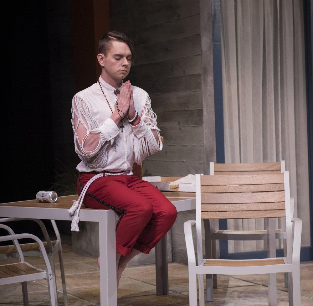 Tartuffe (Shea Nolan) takes a moment to pray. Photo: Natalia Perez