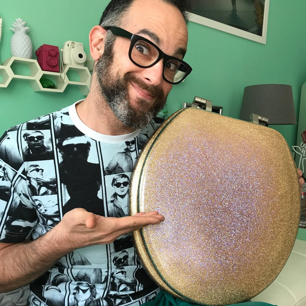 "Zachary Z. Handler holding ""The Most Majestic Toilet Seat"" made by Diza Hope of Glitter my World!"