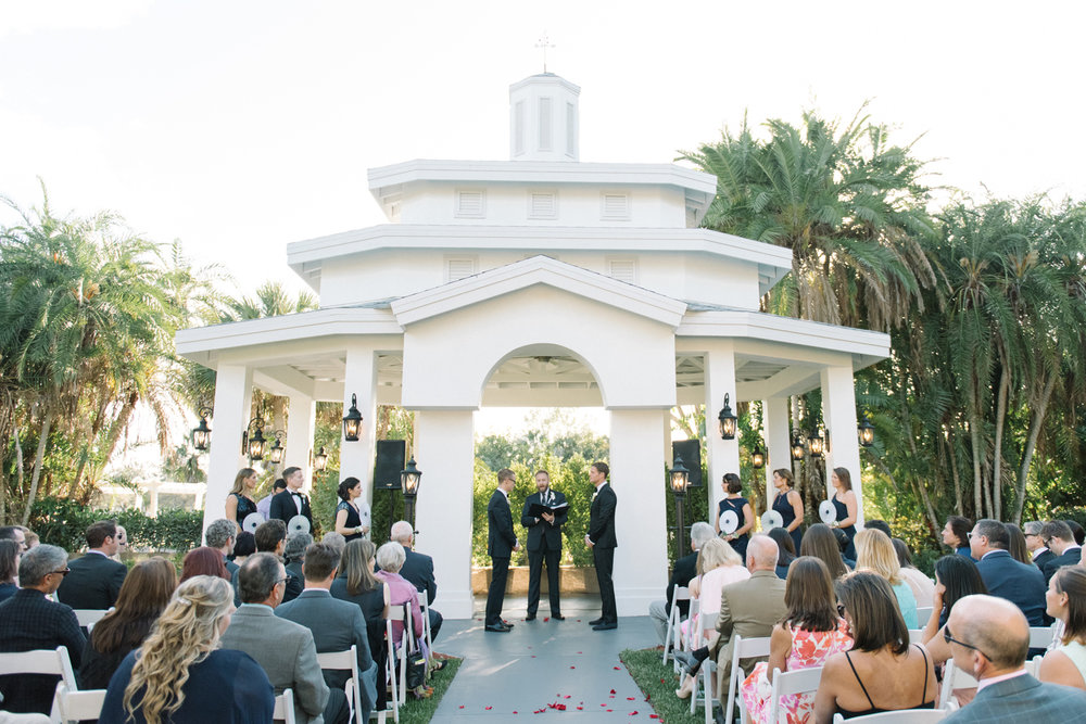 The outdoor ceremony took place under blue skies and this beautiful gazebo. Photo Credit Shea Christine Photography