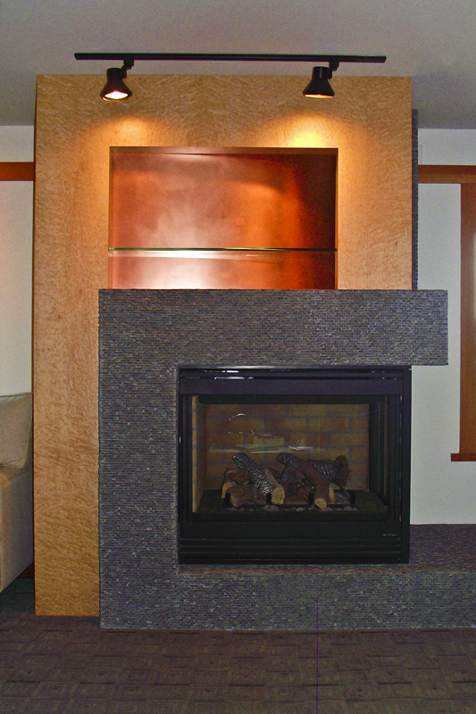 birdseye-maple-and-slate-mosaic-tile-fireplace-with-copper-accents.jpg