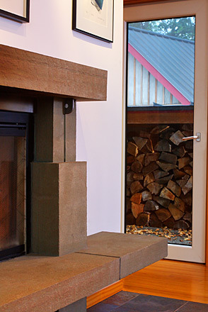 blue stone fireplace and wood storage.jpg