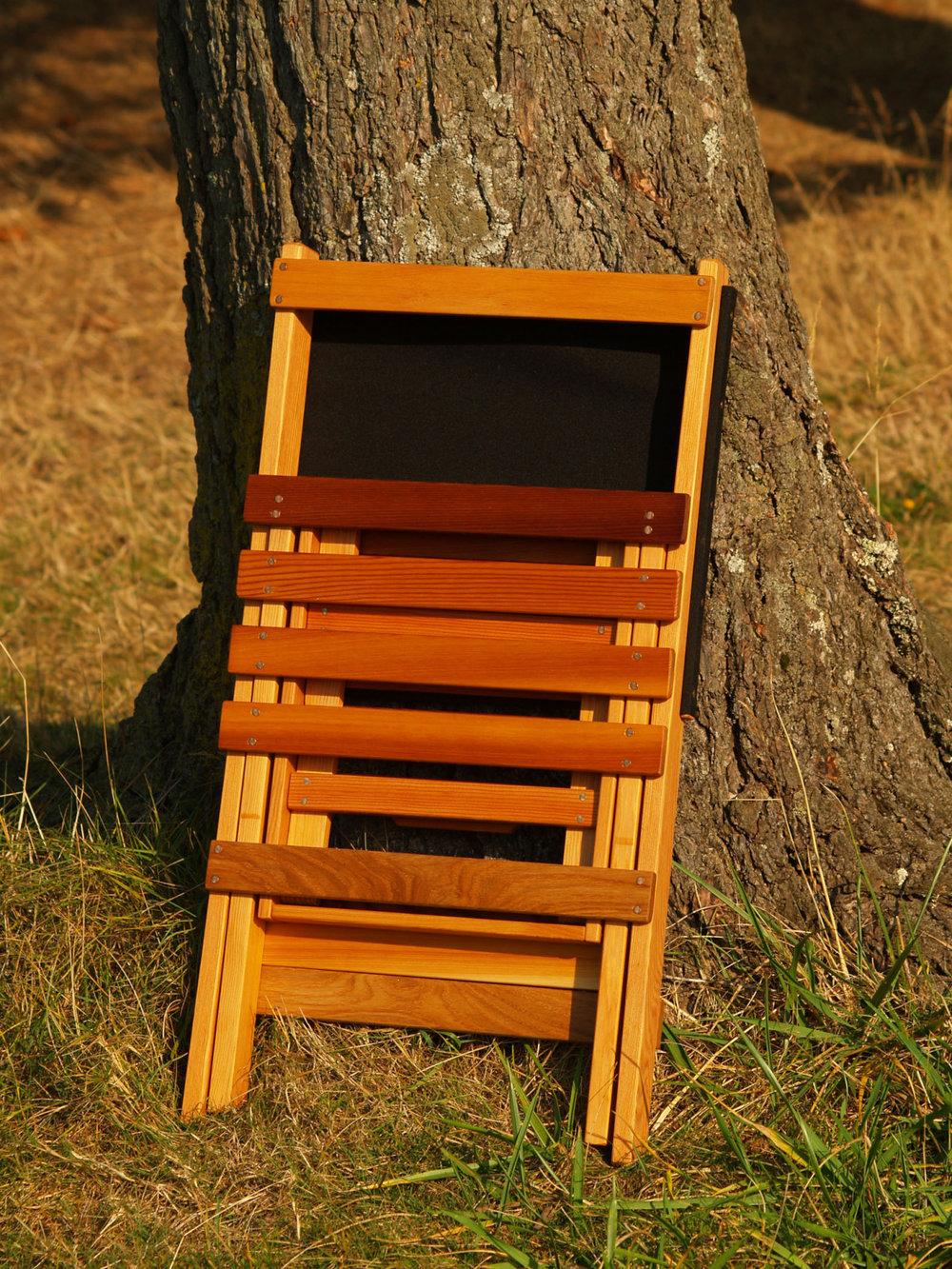black canvas jackass folding patio chair.jpg
