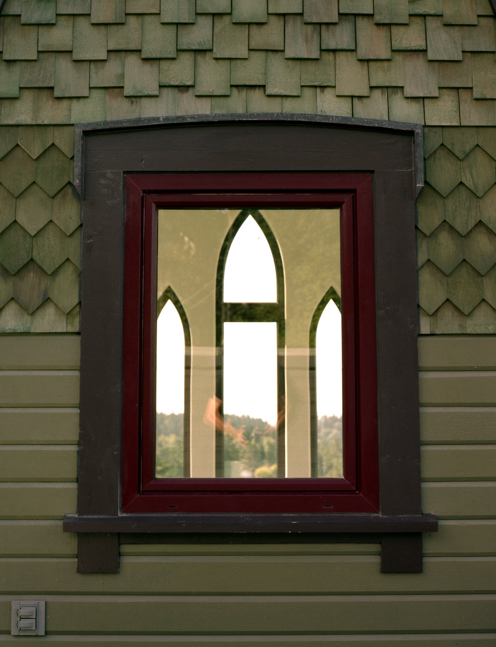 Gothic Mansion exterior window and shingle woodwork.jpg