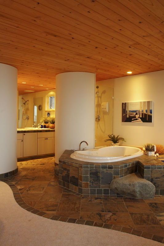 master-bathroom-with-focal-point-bathtub-with-stone-and-tile.jpg