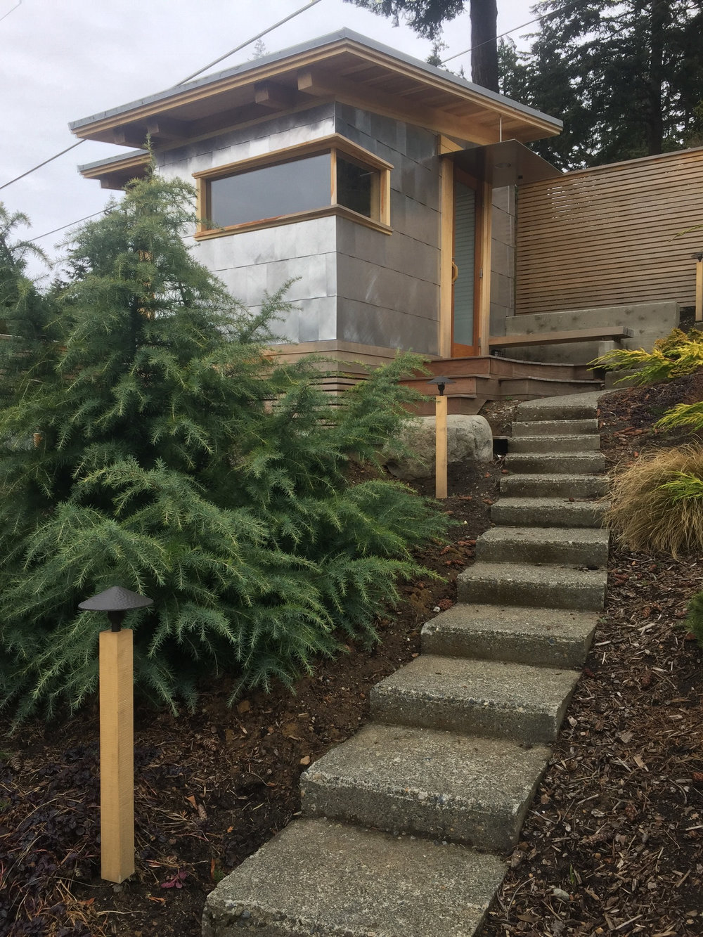 metal shingled sauna and lighted footpath.jpg