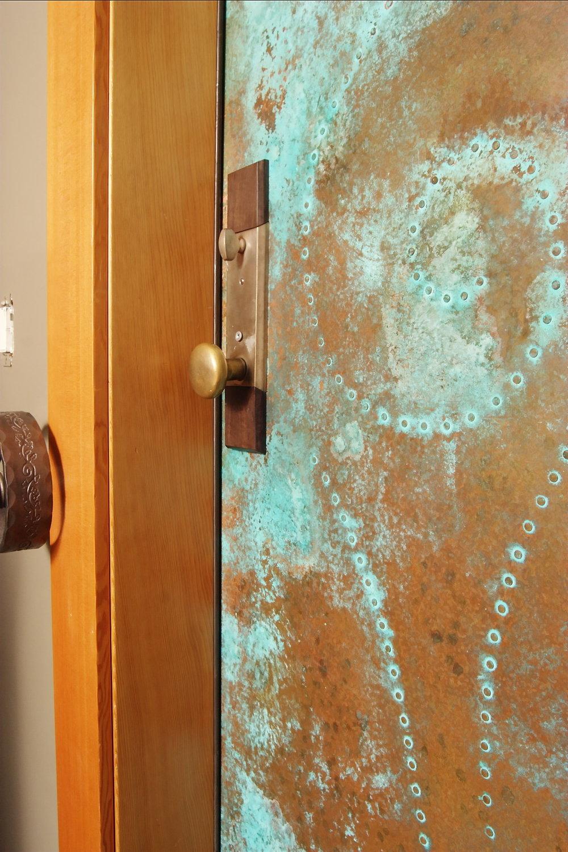 oxidized green copper door detail.jpg
