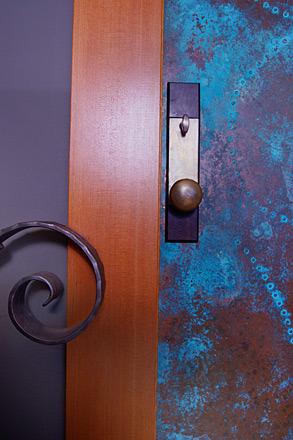 oxidized green copper door doorknob metal detail.jpg