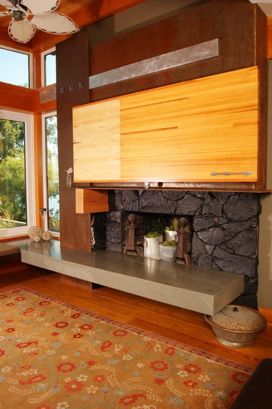reclaimed bowling alley wood feature wall and TV enclosure with graphite-burnished quartz stone fireplace.jpg