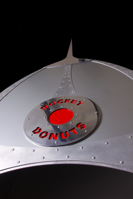 Rocket Donut custom-fabricated metal display case logo detail.jpg