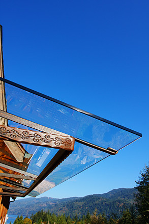 sustainable farm carved wood and glass balcony awning detail.jpg