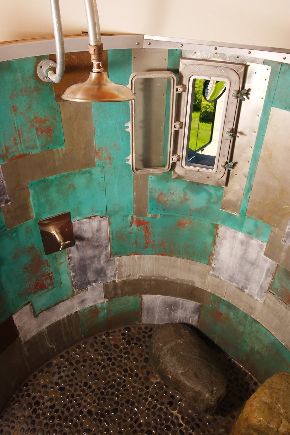 Patchwork Oxidized Copper Circular Shower with Porthole and Natural Stone