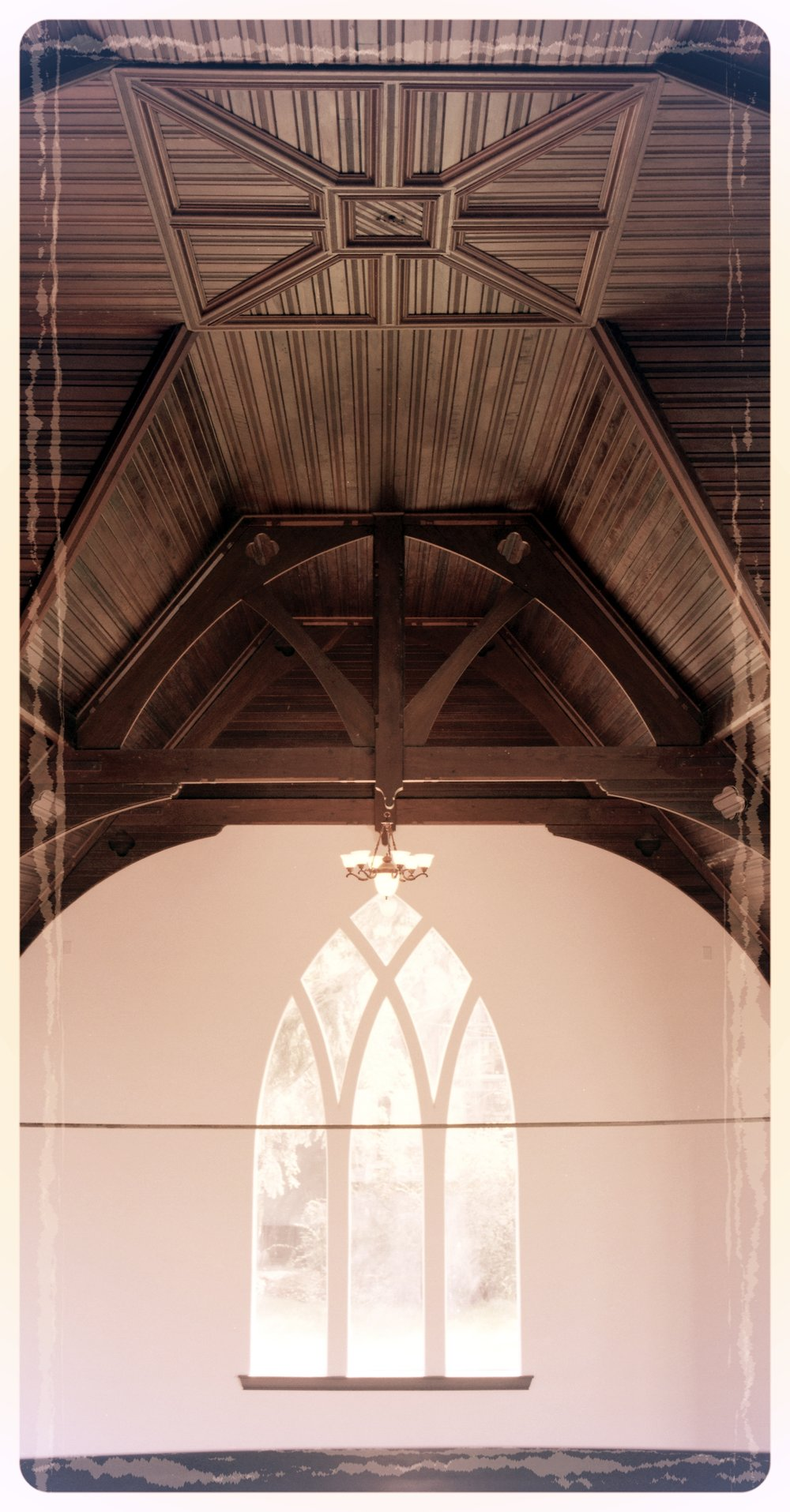 Gothic mansion interior ceiling woodwork detail and peaked arched window.jpg