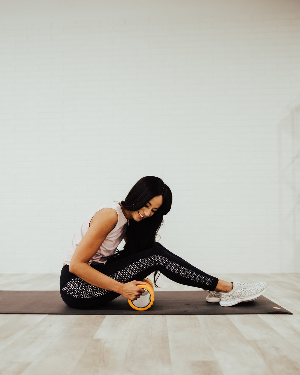 Place the foam roller perpendicular to the back of your thigh, keeping clear of the back of your knee.  Roll back and forth for 2-3 minutes. You can do either two legs at a time (both on the foam roller) or to increase the intensity cross one leg over the other.