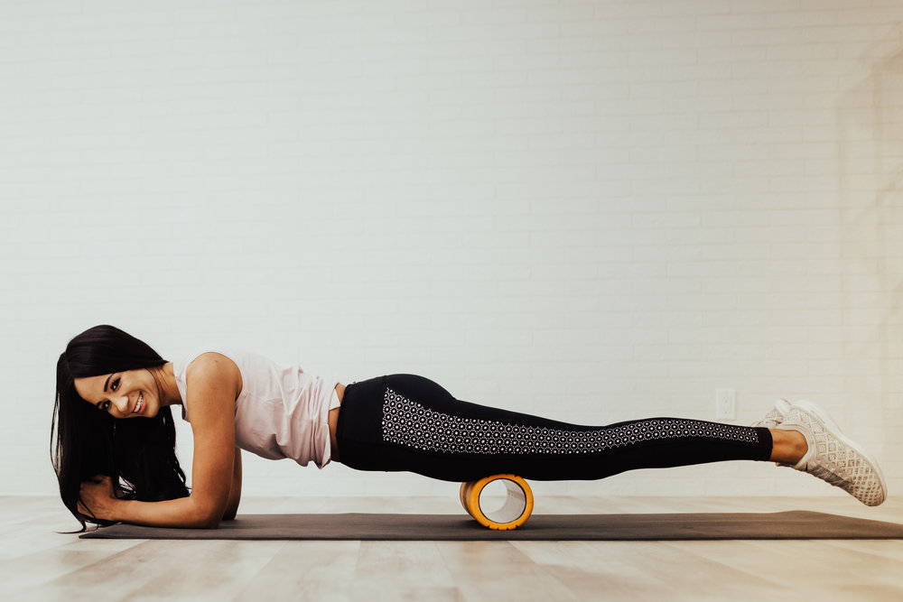 Place the foam roller perpendicular the front of your thigh whilst in the plank position. Again, you can roll with either two legs on the foam roller or one , which will increase intensity.  I often find that the hand-held roller works my quads more easily.