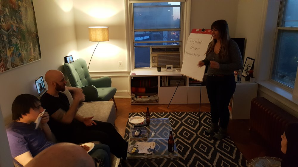 Kate introduces a meeting in her apartment