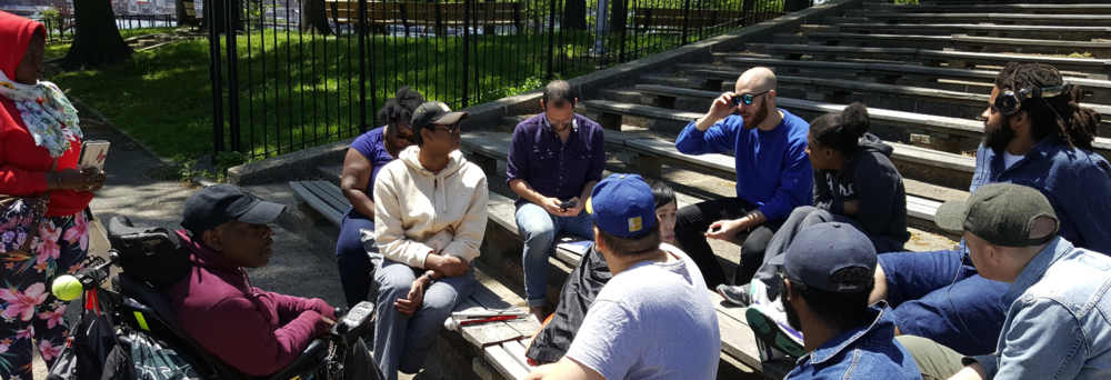 Reuben facilitates a discussion on building power with people with disabilities and residents of Crown Heights.