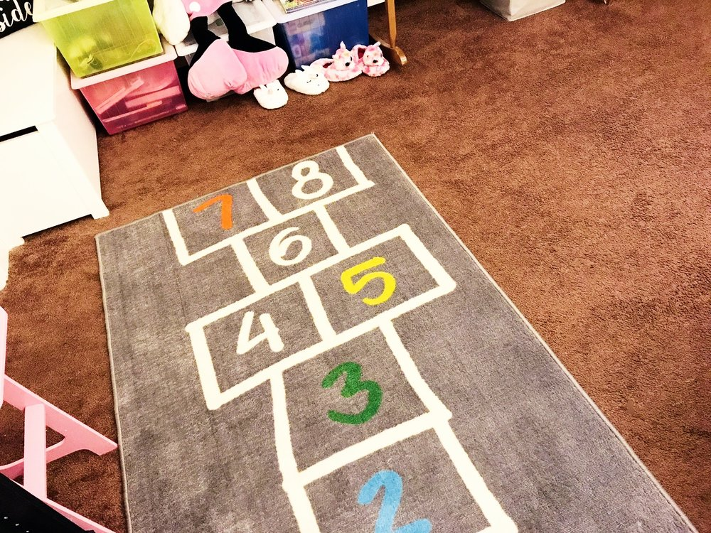 This hopscotch rug is also from Ikea. Leah loves playing this game outside after drawing it on the ground with chalk. It was such a cute find and cool to be able to play it indoors as well.