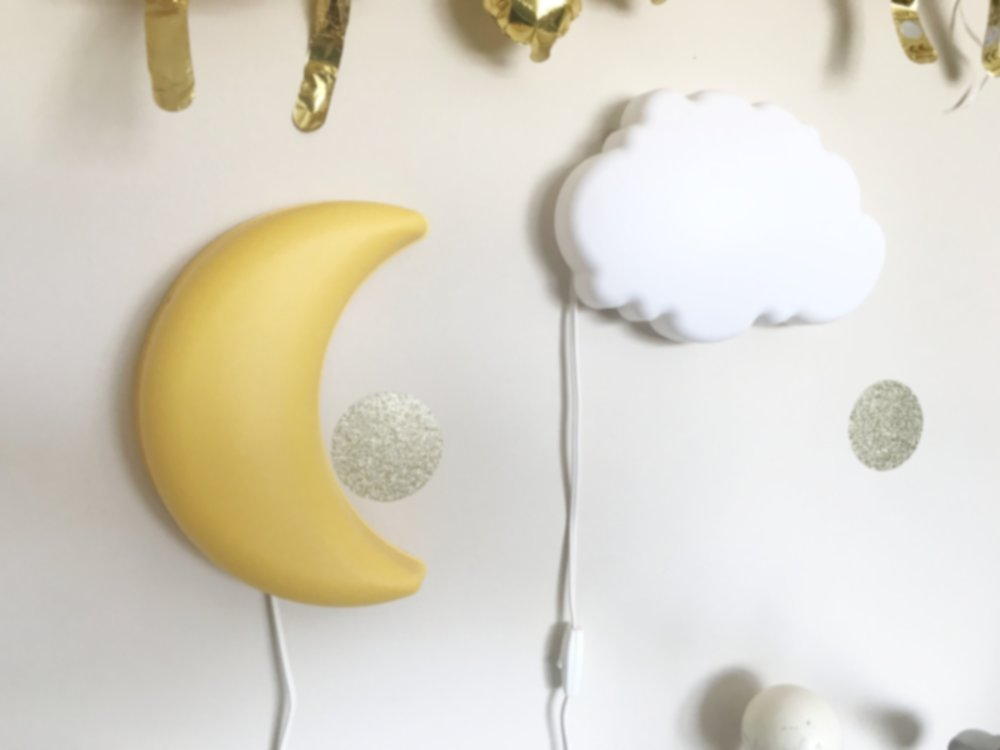 I kept the hooray balloons from their birthday and the dots on the wall are mini gold glittered wall decals. The moon and star I found at IKEA. Leah uses them as nightlights
