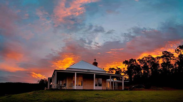 Hard to believe that 6 years ago today we lost our family home to the Millingandi bushfires. I wanted to share this photo of the recently (almost) finished home mum has been busting her arse on for the last few years (with help from others). It's an amazing house that compliments the original beautifully. This sunset capture reminds me of a stylised version of the flames ravaging the nearby bush and home on that fateful day. ——————————————— Shot as 6 individual photos on my phone and stitched together as a panorama. #sunset #sunsetmadness #bushfire #home #seaview