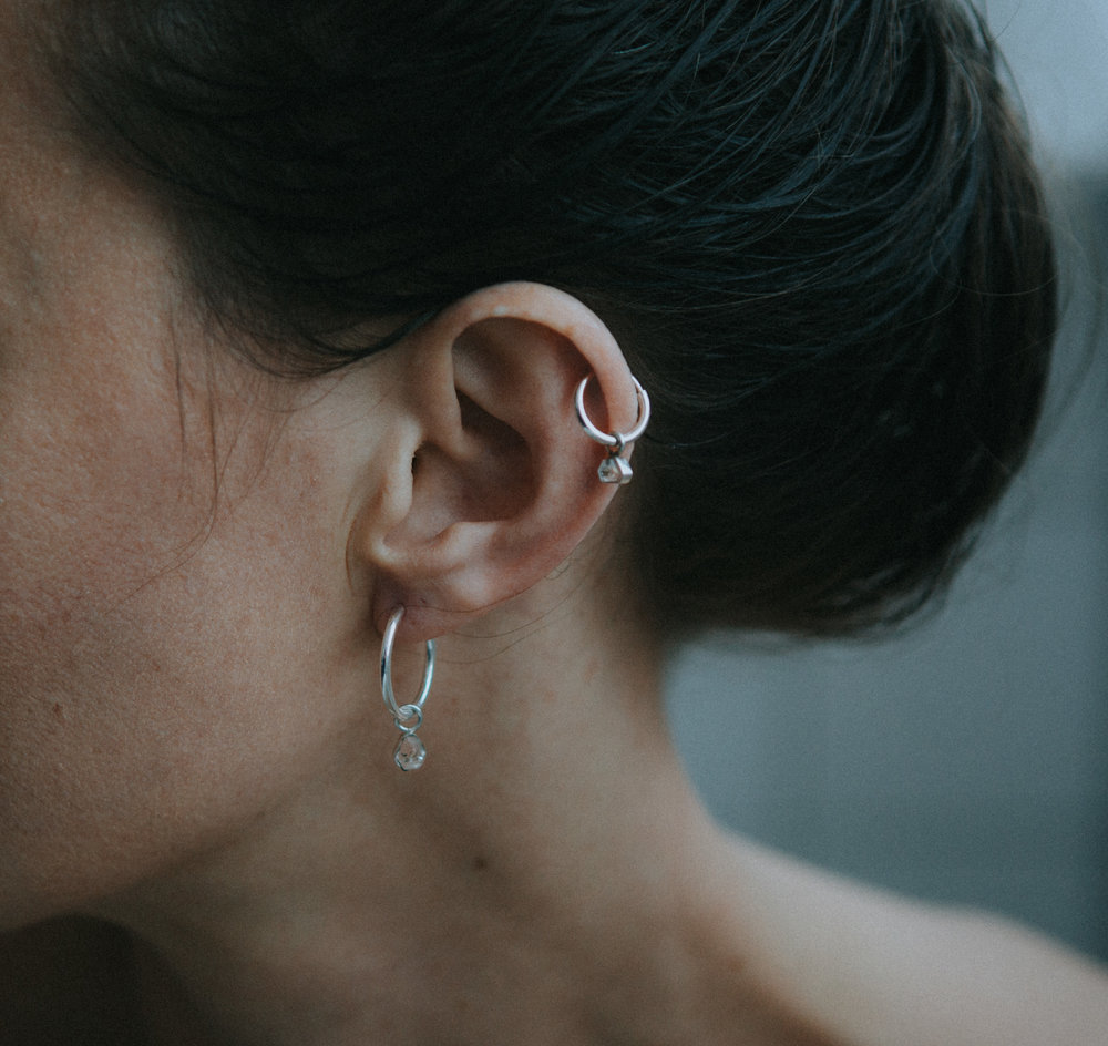 EYESEEi. AAVRE Mini & AAVRE Small hoop. Partly Sterling silver and recycled Sterling silver with one raw Herkimer diamond crystal. The word means success and happiness in the Southern Sami dialect. Price: 380 SEK Photo: Anna Maria Liljestrand