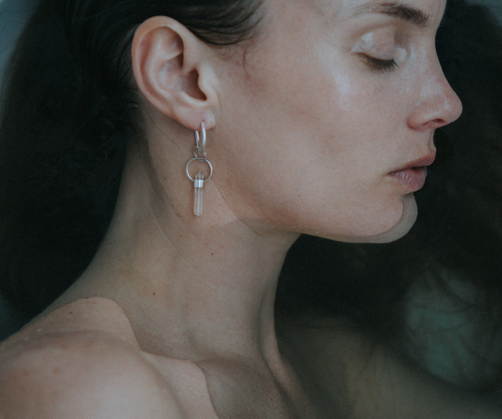EYESEEi. EXPANSION earring with a roughly cut clear quartz crystal wand set in Sterling silver, partly in recycled sterling silver. Price: 440 SEK Photo: Anna Maria Liljestrand
