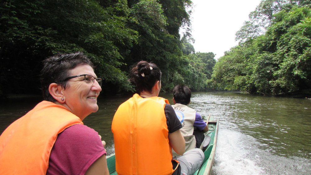 Traveling in Longboat on Melinau River