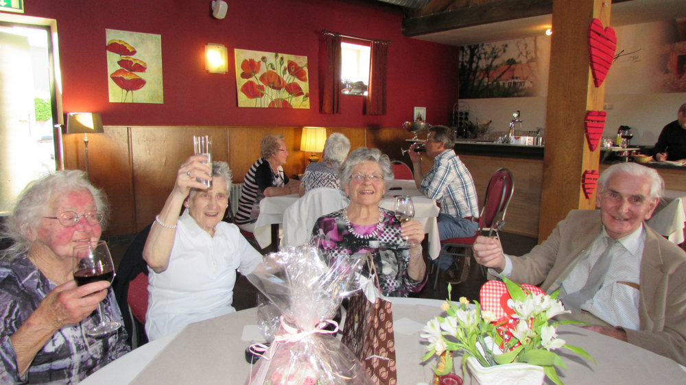 Oma Janssen toasting on her 85th birthday