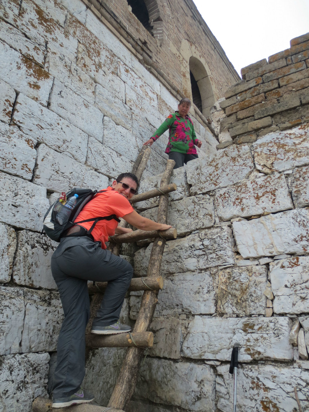 Climbing ladders into the old defence towers on the Great Wall