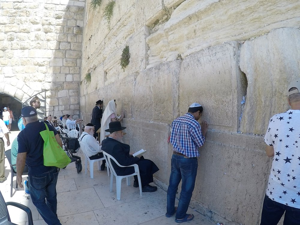 Jewish men praying at the Western Wall in the Old City of Jerusalem.