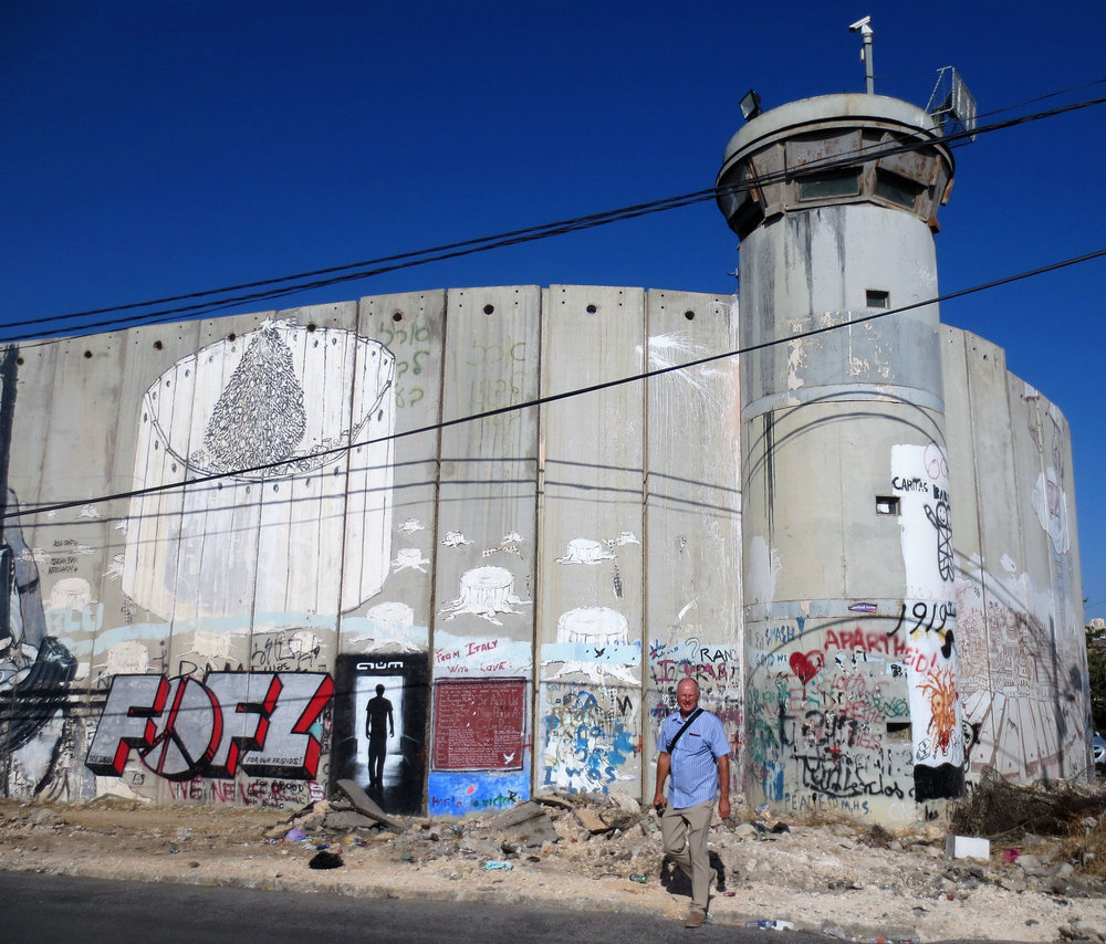 Security wall in Bethlehem. It separates the West Bank from Israel. Here it is eight meters high. It is called the separation barrier by the Palestinians and they put beautifull graffiti (Banksy) on.