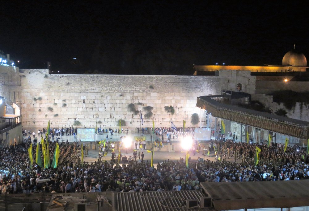 Inaugural ceremony of the Golani Brigade on the Western Wall Plaza. In the top right you see the Dome of the Rock, third holiest place in the world for the Muslims.