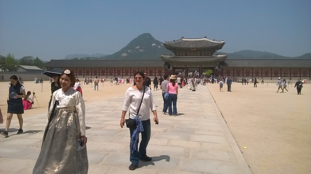 At the Royal Gyeongbokgung Palace with local tourist wearing a hanbok