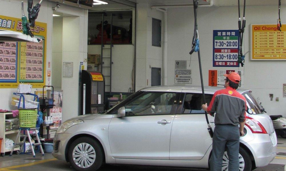 'Air born' filling nozzles at petrol station in Tokyo