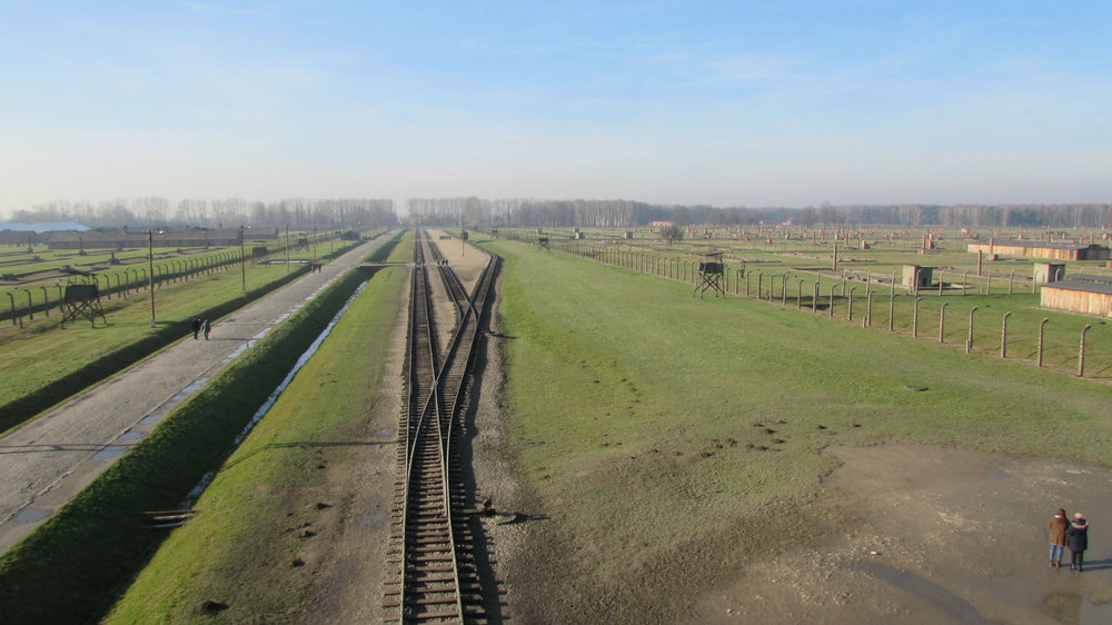 Parallel rail tracks cutting through Birkenau