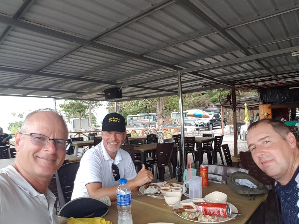 Elliott, Peter and Frank having rice lunch in Tangjung Pengelih