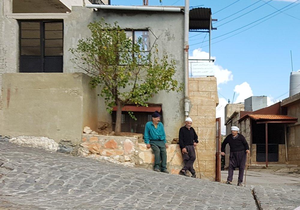 Druze men watching us strangers