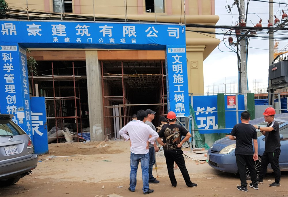 Chinese supervisors working on casino construction site.