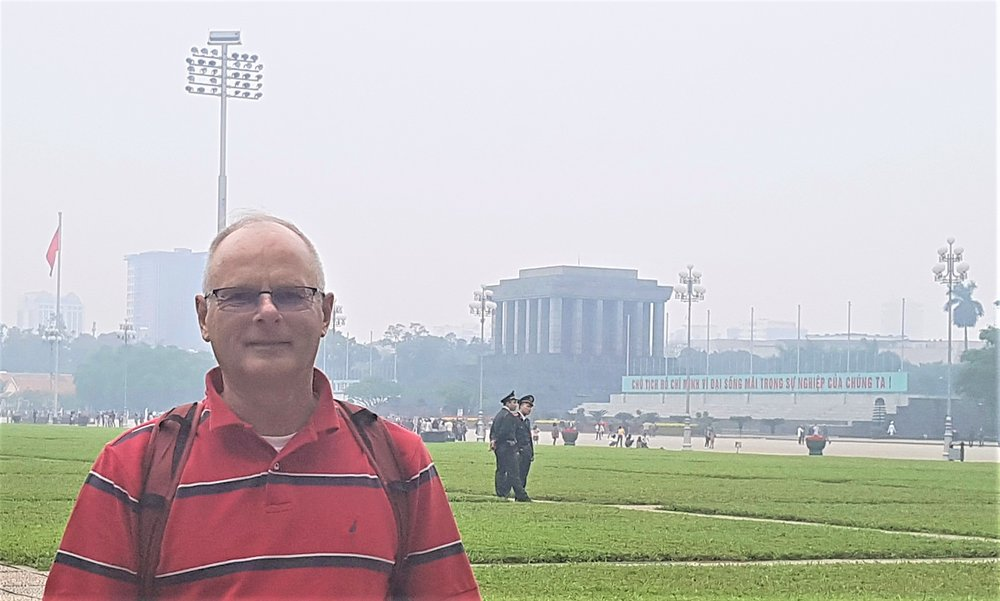 In front of Ho Chi Minh mausoleum. Note the haze, shrouding the city in a thick fog