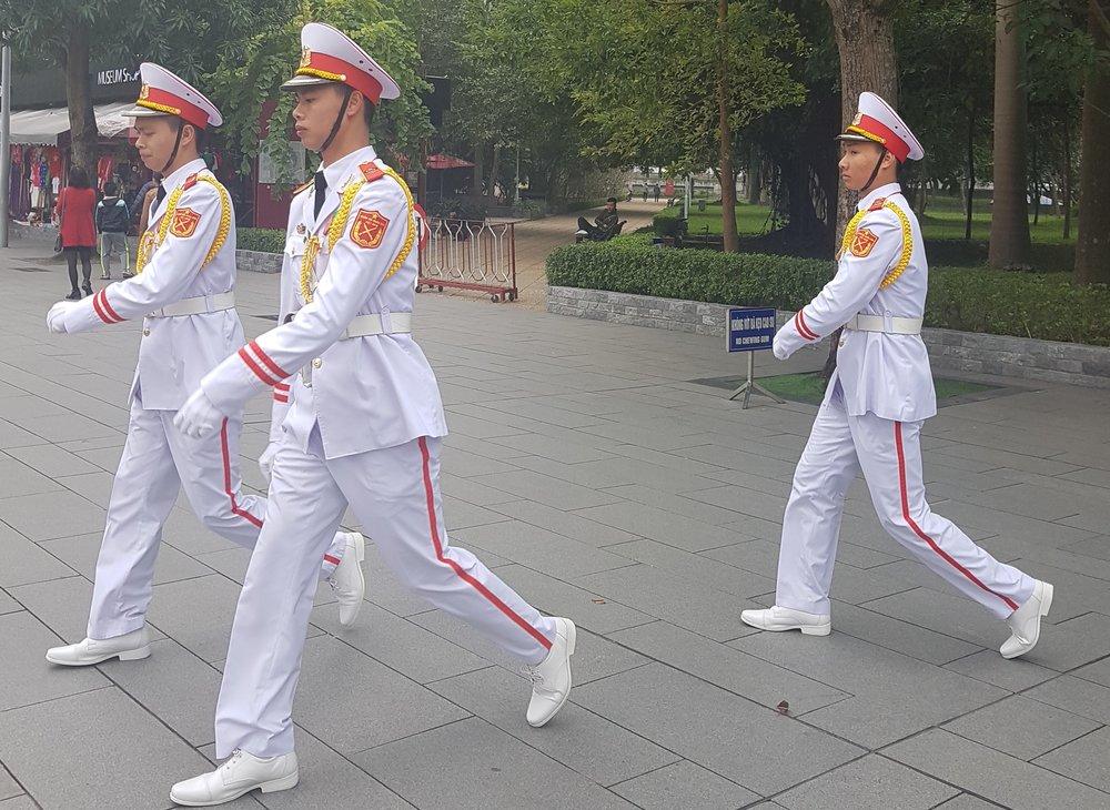 Uniformed guards at mausoleum